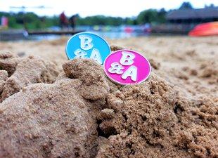 Meningitis Now - B&A Believe & Achieve - Badges in sand