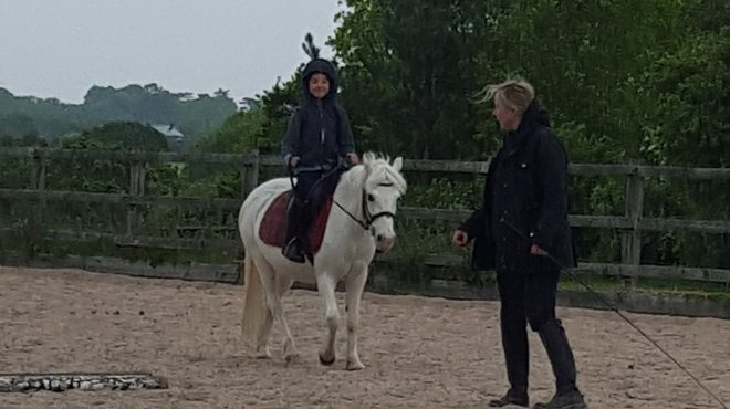 Liam receives funding for horse riding after bacterial meningitis
